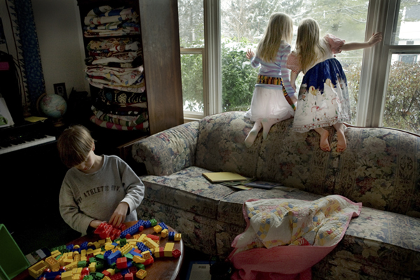 Benjamin Odhner,10, diagnosed with classic autism awaits a diaper change from his father.